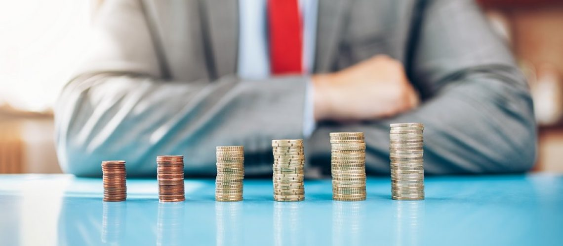 Businessman and his financial investment on the table